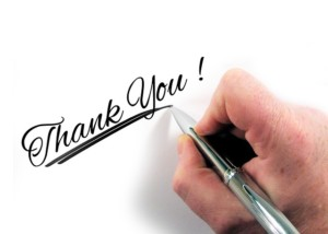 Person Writing Thank You Note
